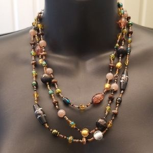 3/$15!  Beaded necklace in tones of gold & brown